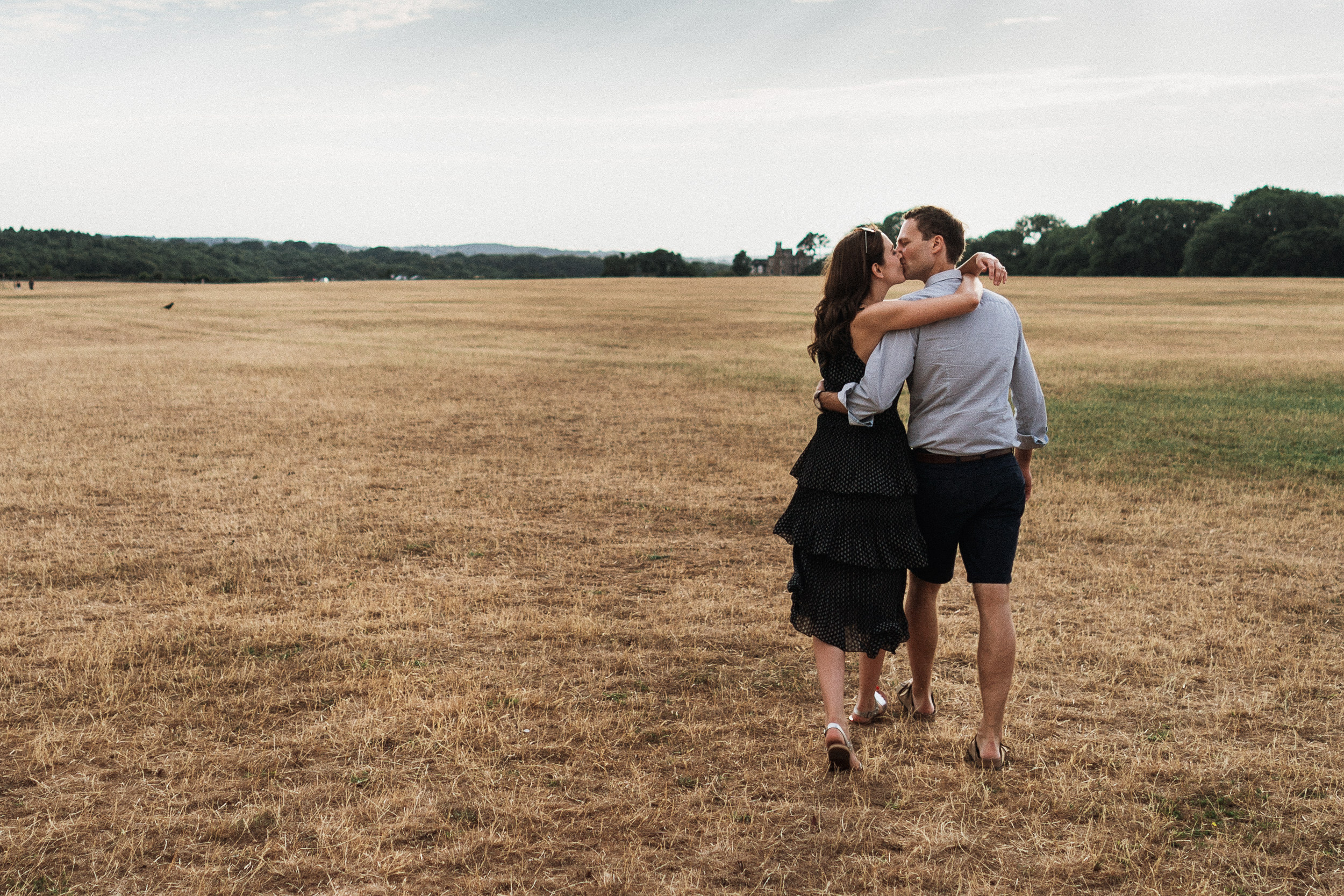 Engagement Shoot on Clifton Downs - The couple walking across the Downs together