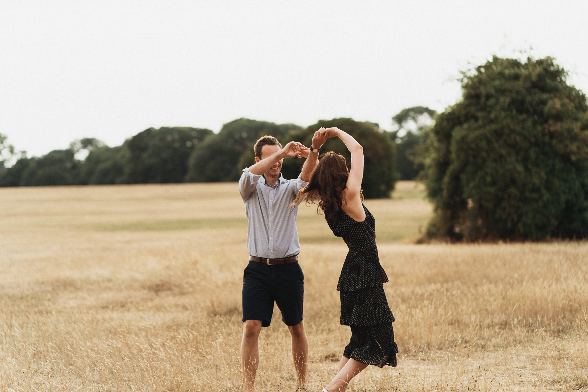 Engagement Shoot on Clifton Downs - The couple dancing on a summer evening