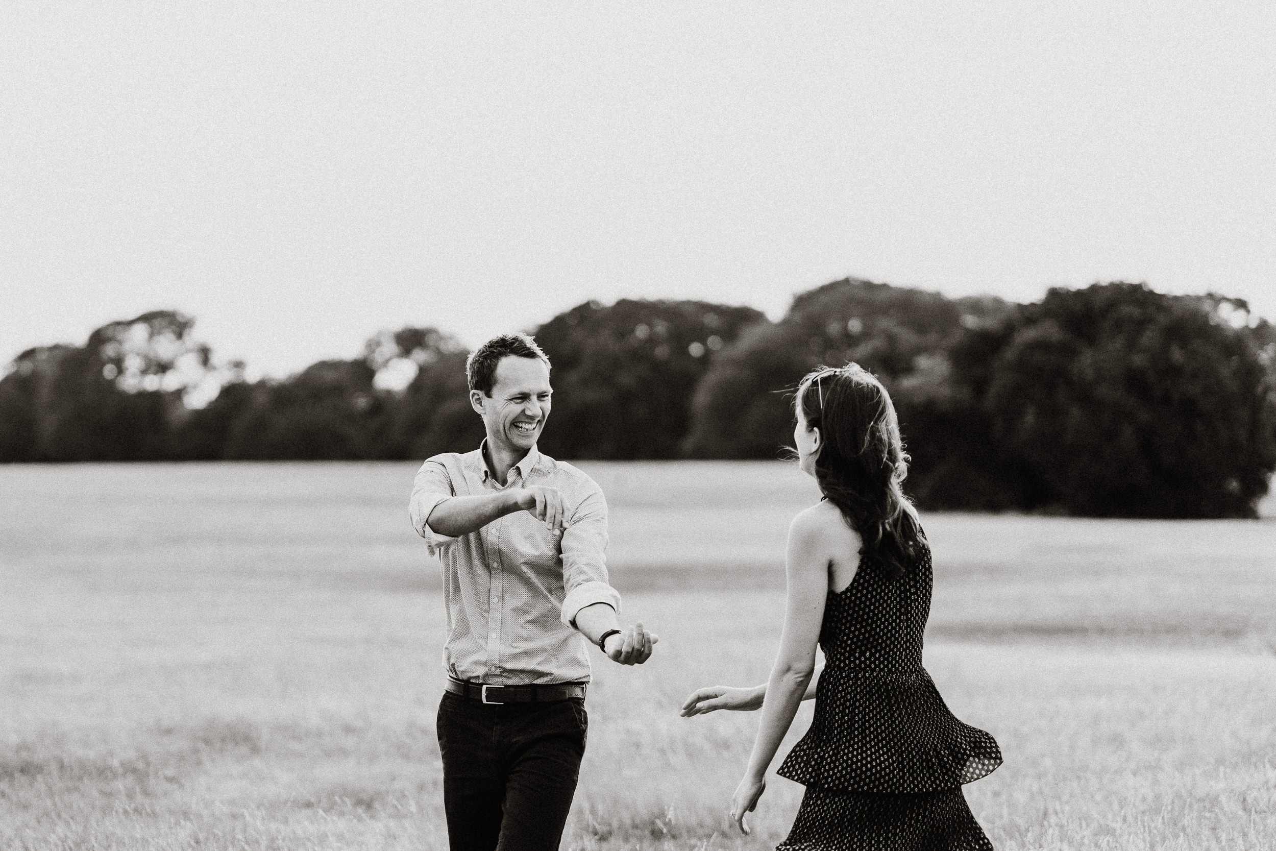 Engagement Shoot on Clifton Downs - The newly engaged couple dancing on the Downs