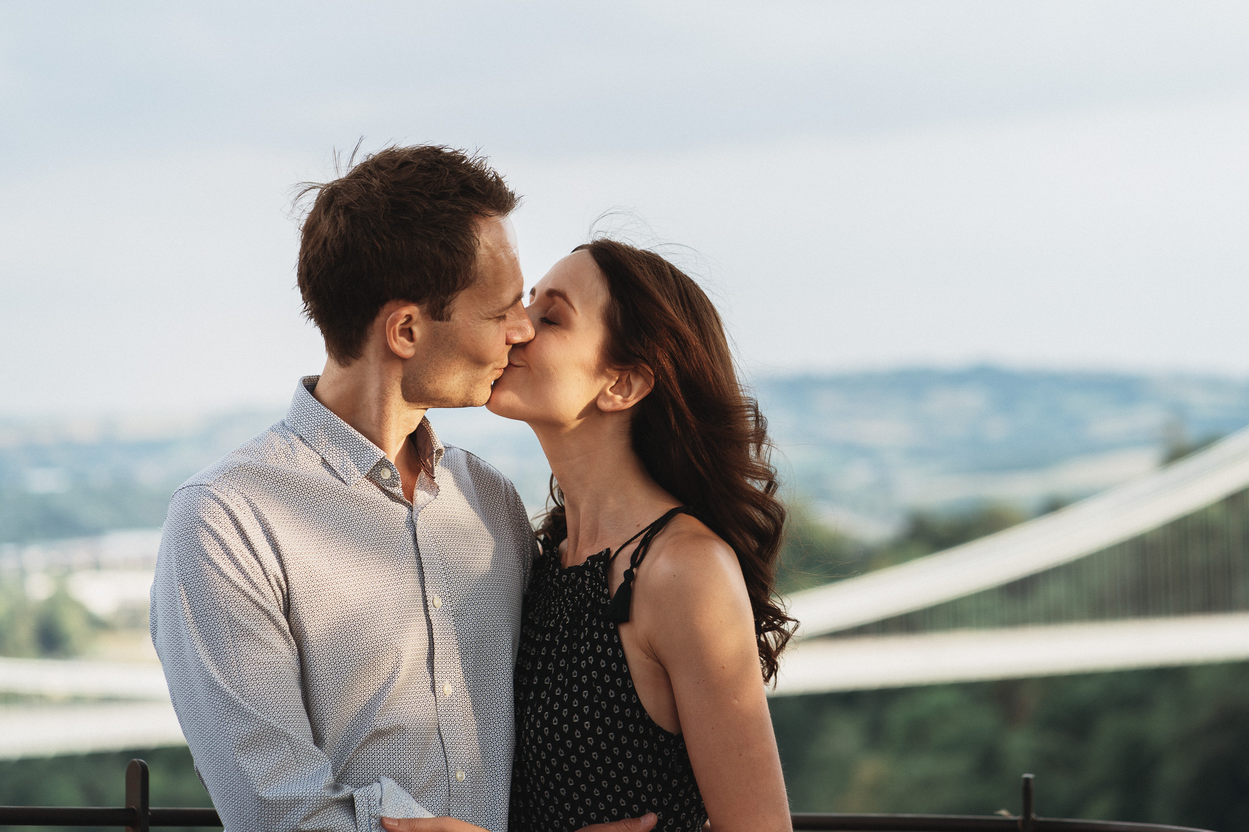 Engagement Shoot on Clifton Downs - Portrait of the couple with the Clifton Suspension Bridge in the background