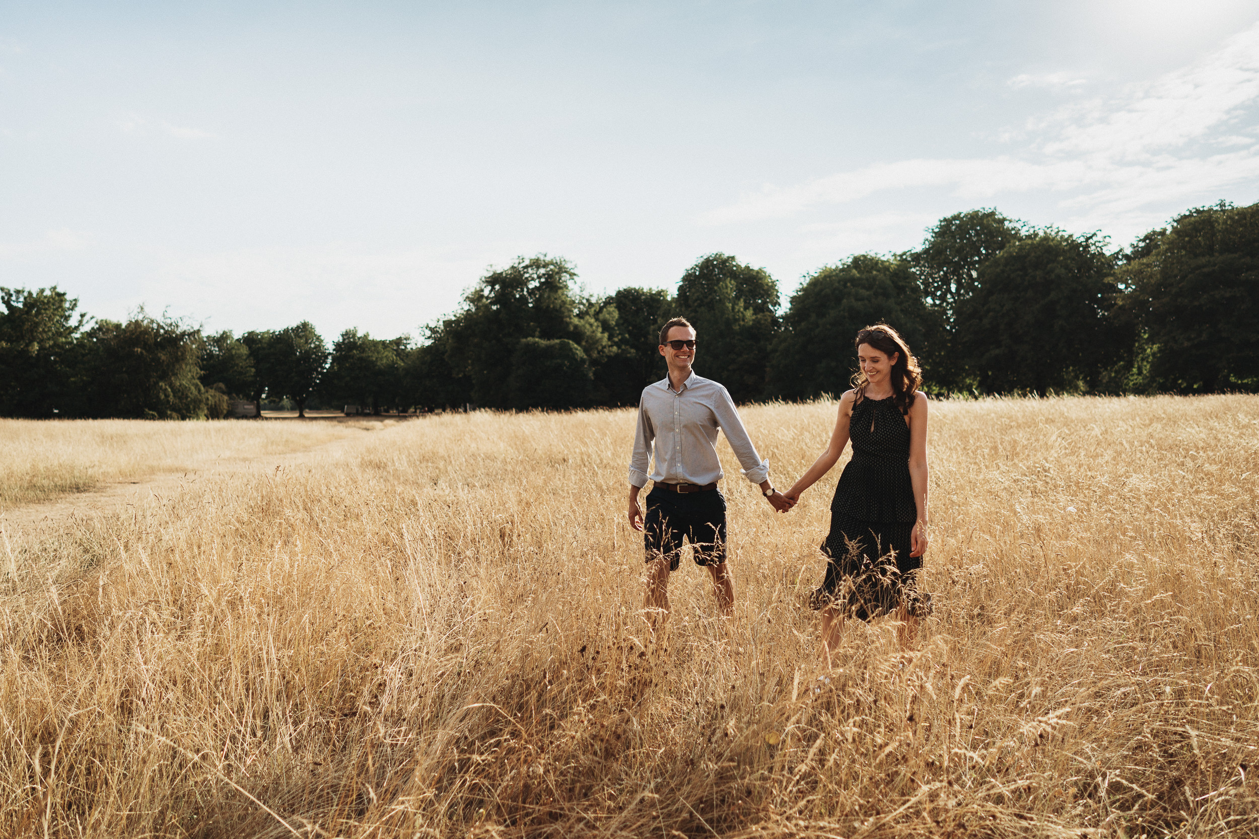 Engagement Shoot on Clifton Downs - Portrait of the couple walking in the long grass