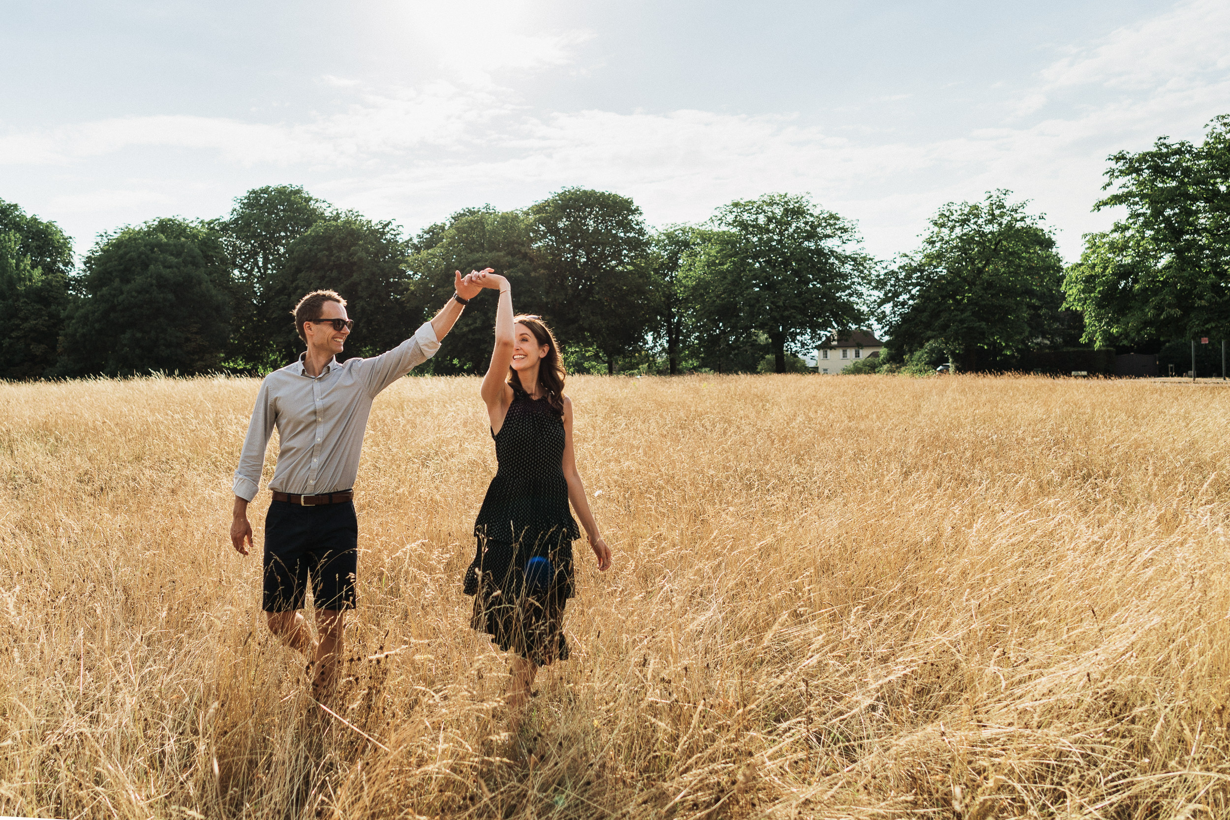Engagement Shoot on Clifton Downs - Portrait of the couple dancing in the long grass