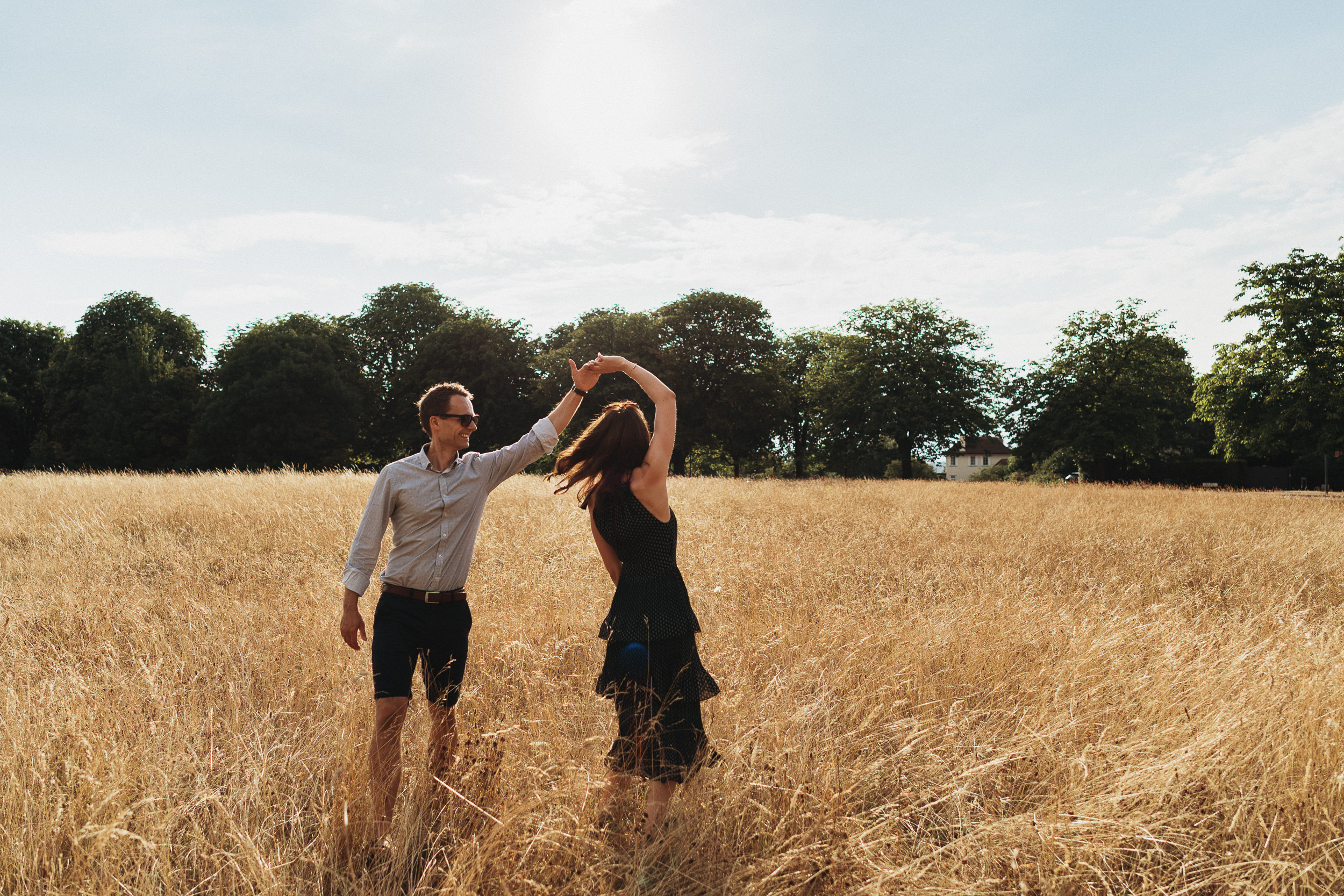 Engagement Shoot on Clifton Downs - The couple dancing on the Downs