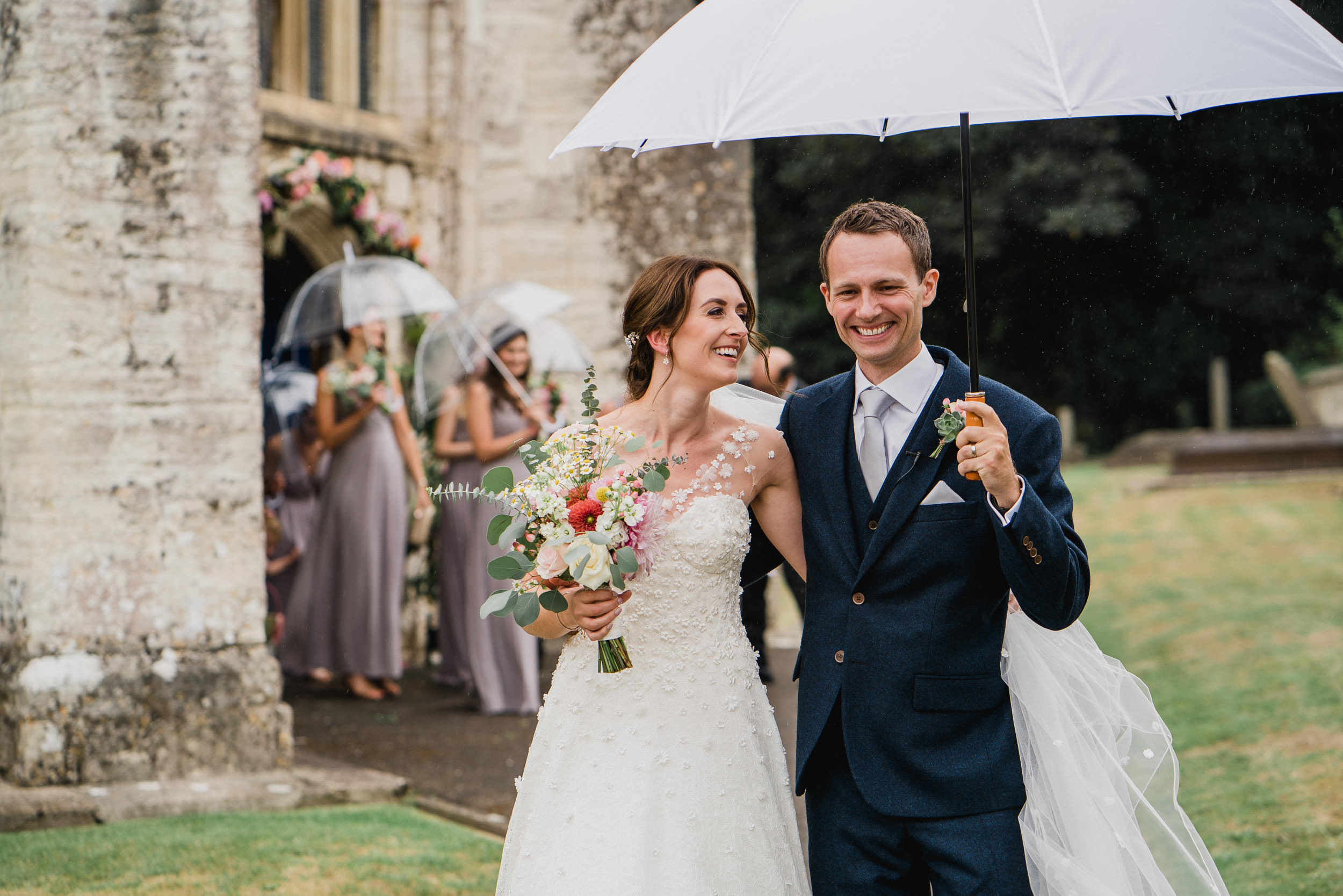 Orchardleigh Estate Wedding - Bridal Party leaving the Church with Umbrellas