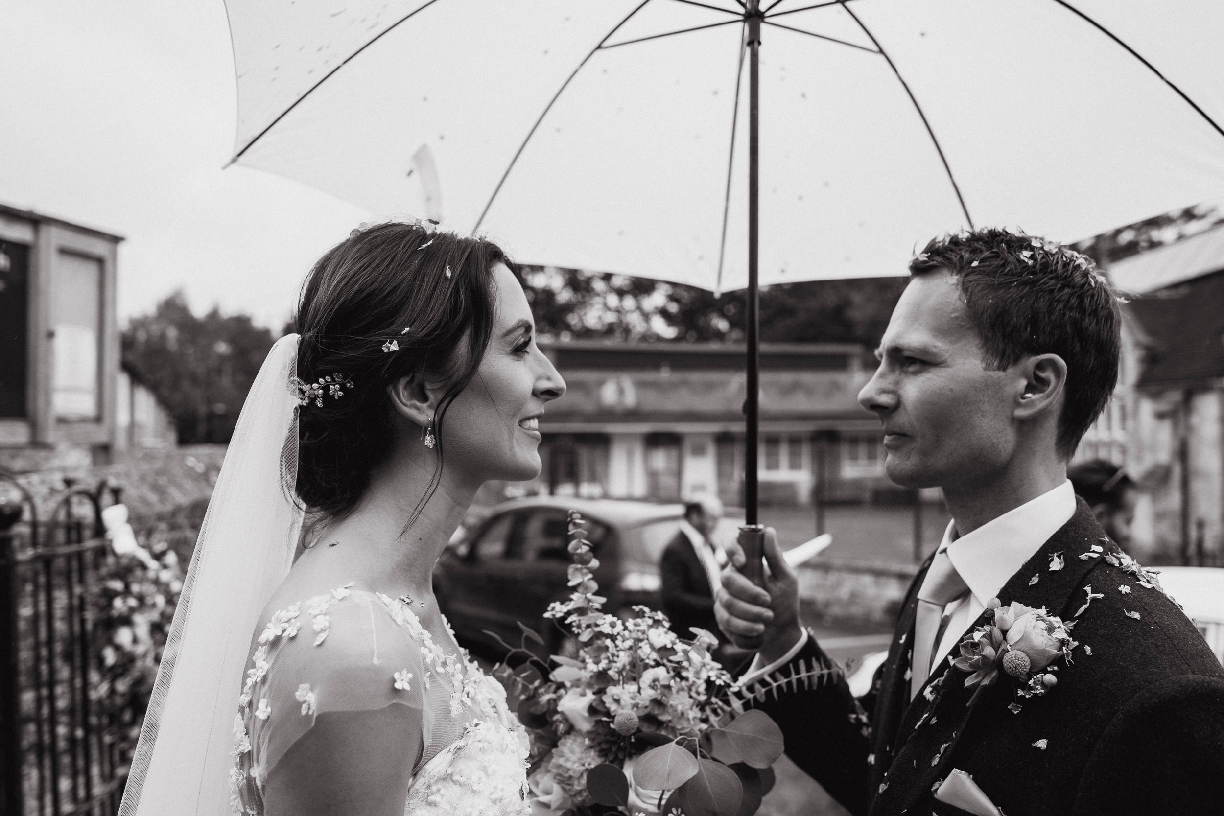 Orchardleigh Estate Wedding - Bride and Groom outside Church with Umbrellas