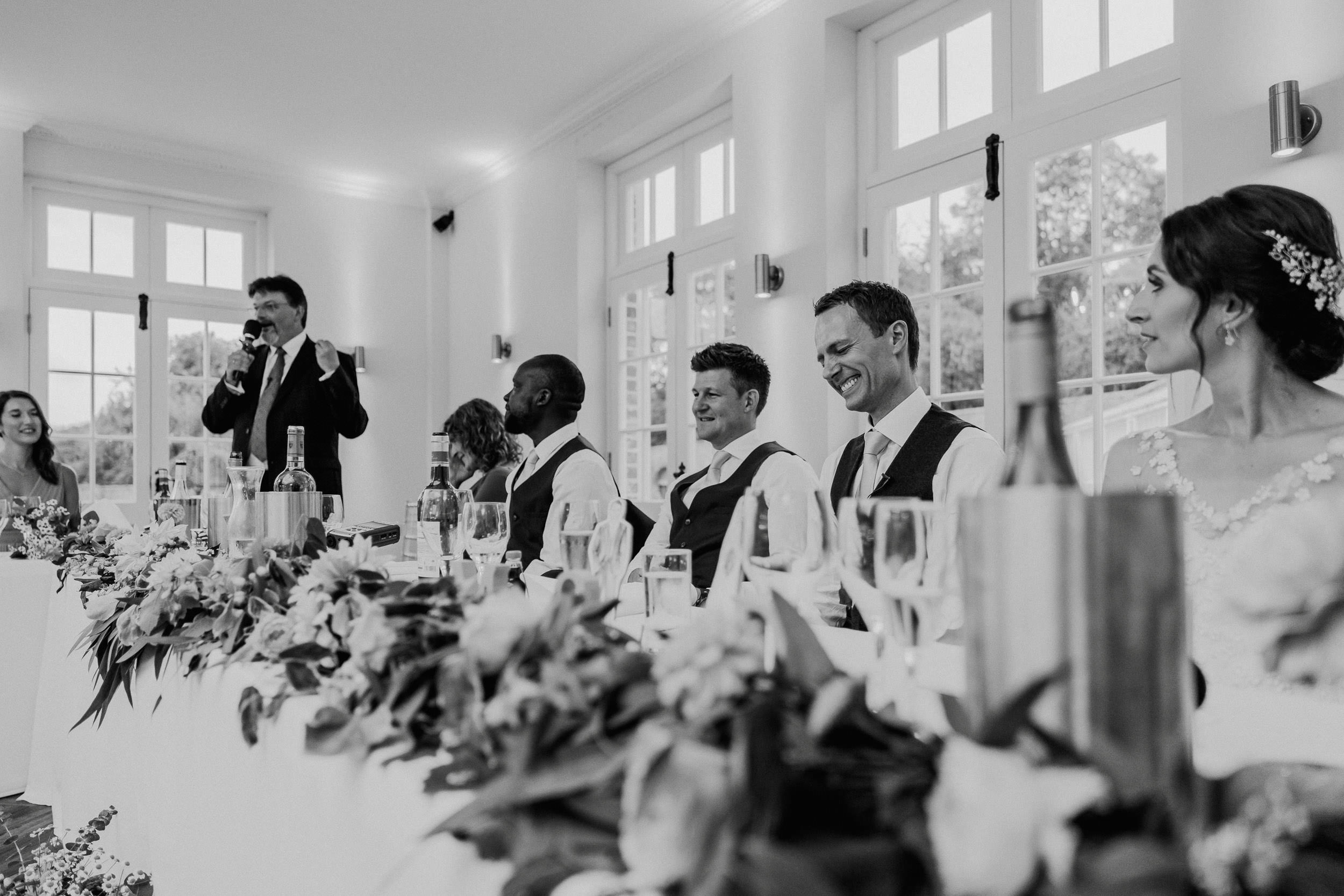 Orchardleigh Estate Wedding - Wedding Party laughing during the Speeches
