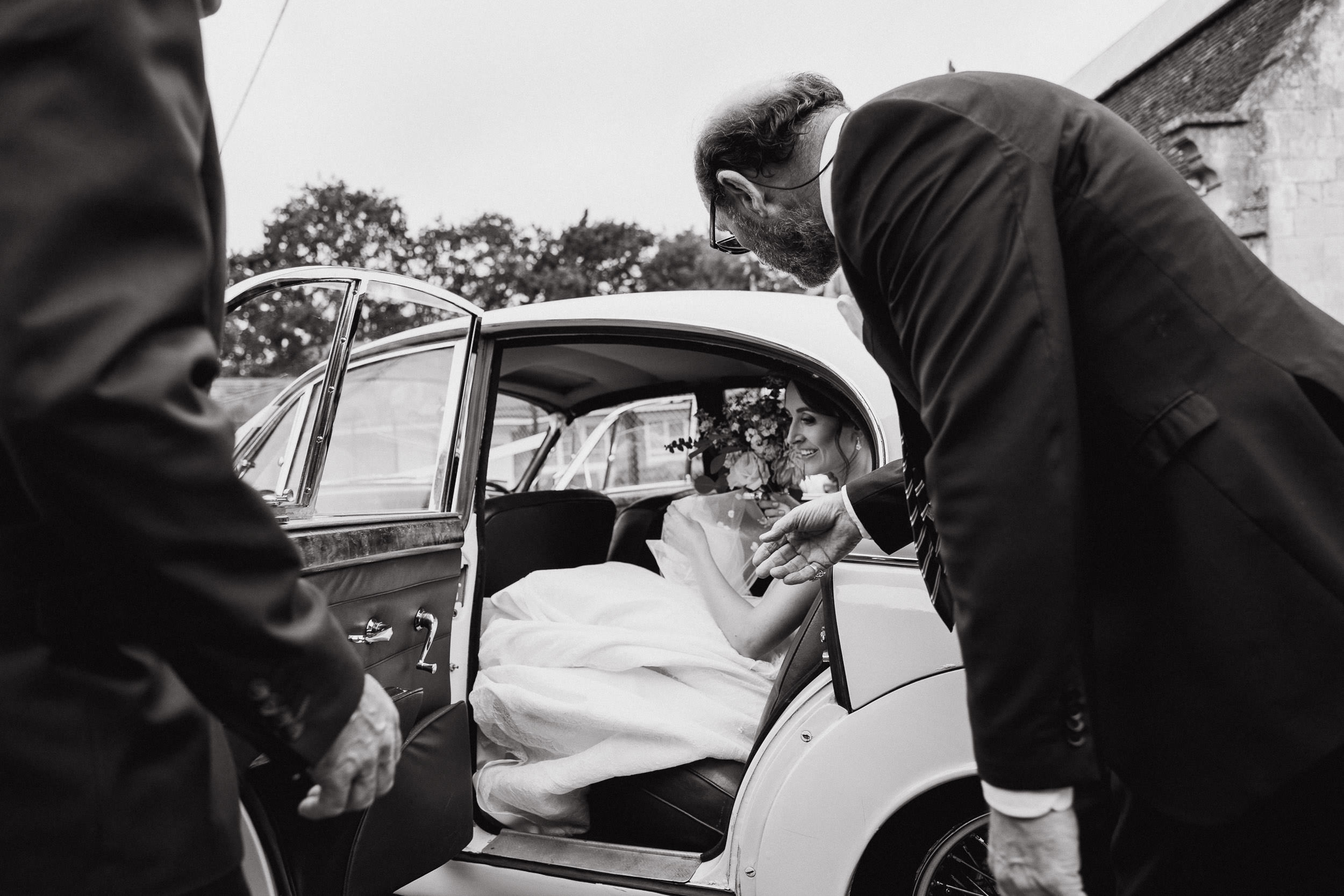 Orchardleigh Estate Wedding - Bride getting out of the Car at the Church