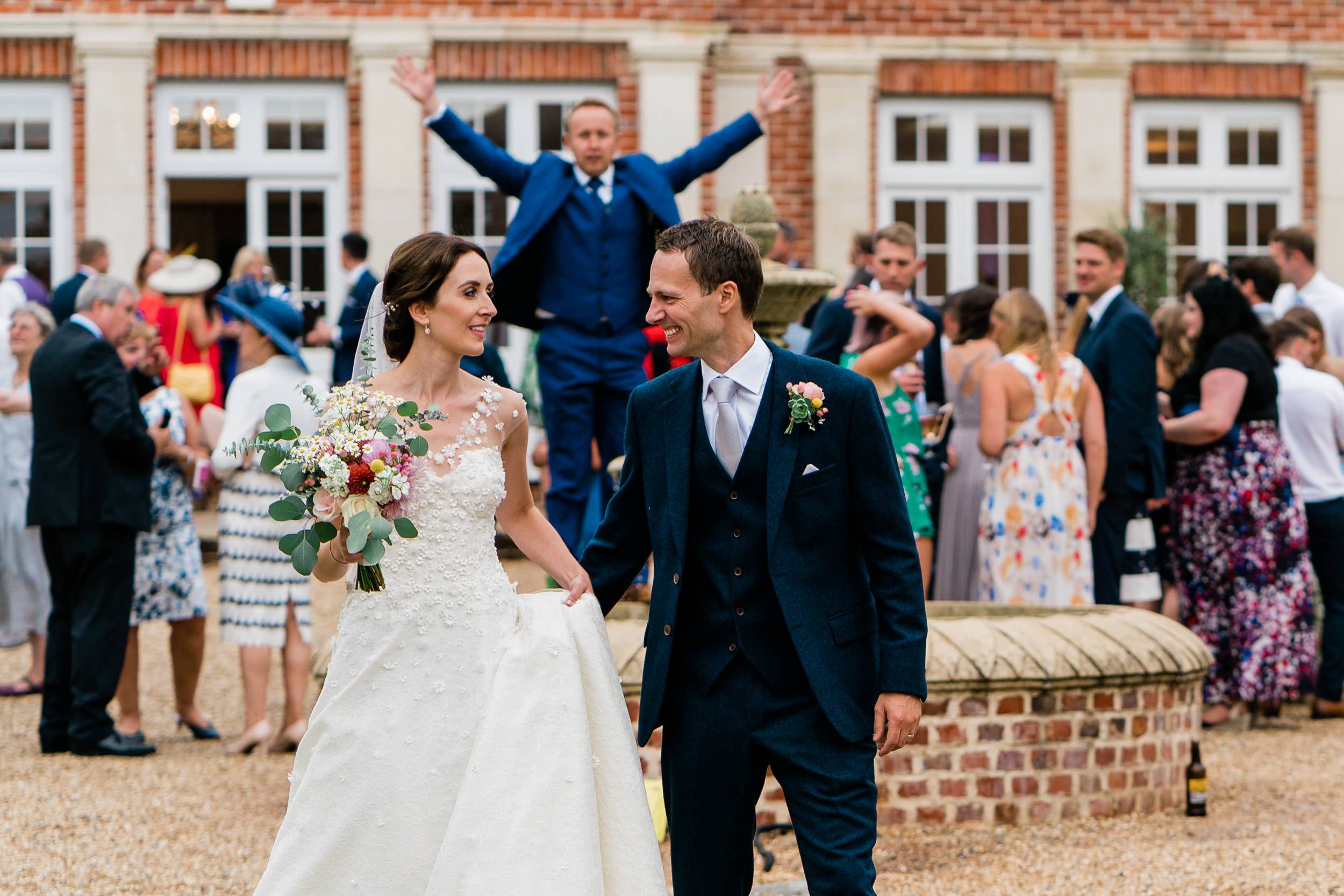 Orchardleigh Estate Wedding - Bride and Groom with Guests in the Walled Garden