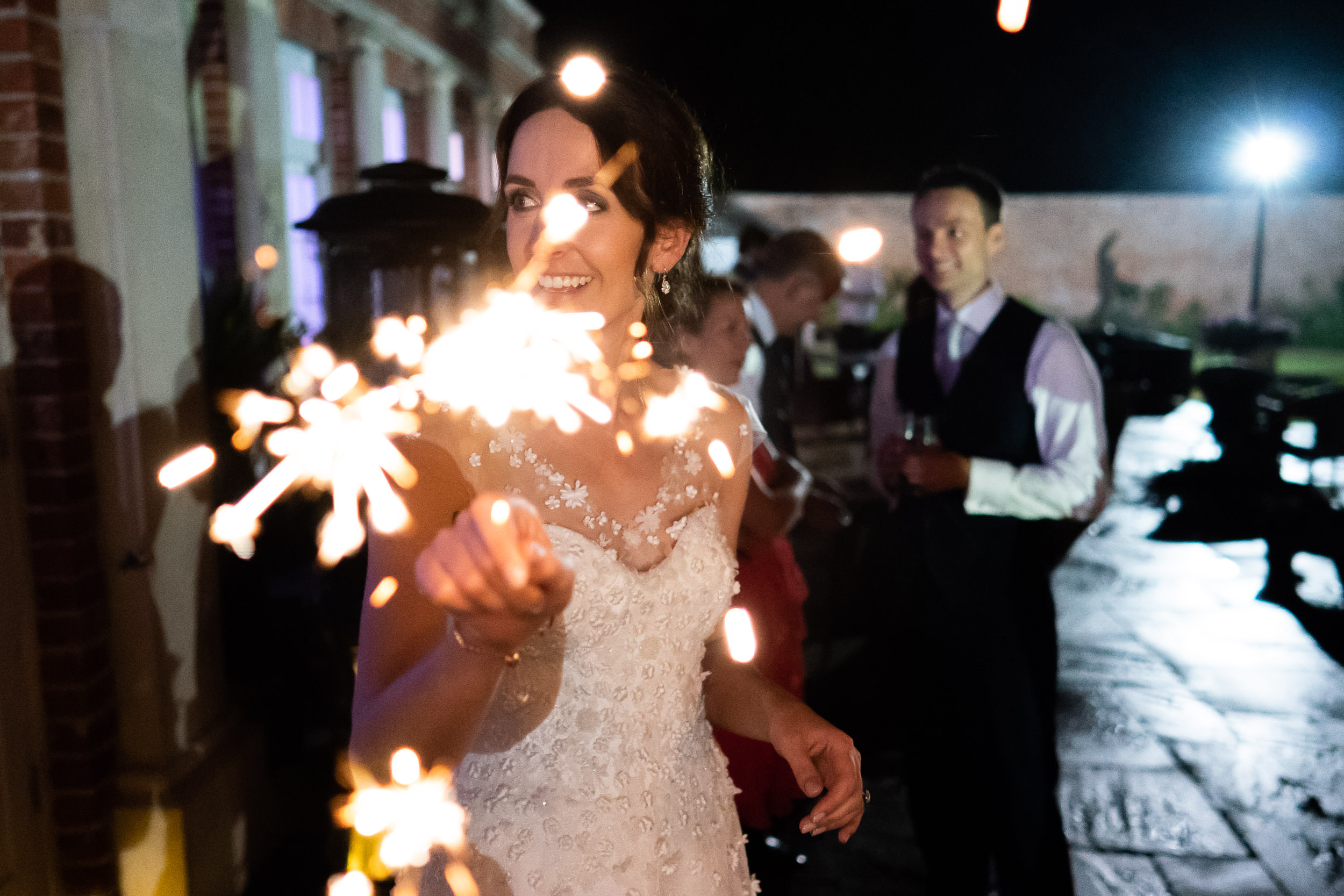 Orchardleigh Estate Wedding - Bride with Sparklers at the Evening Reception