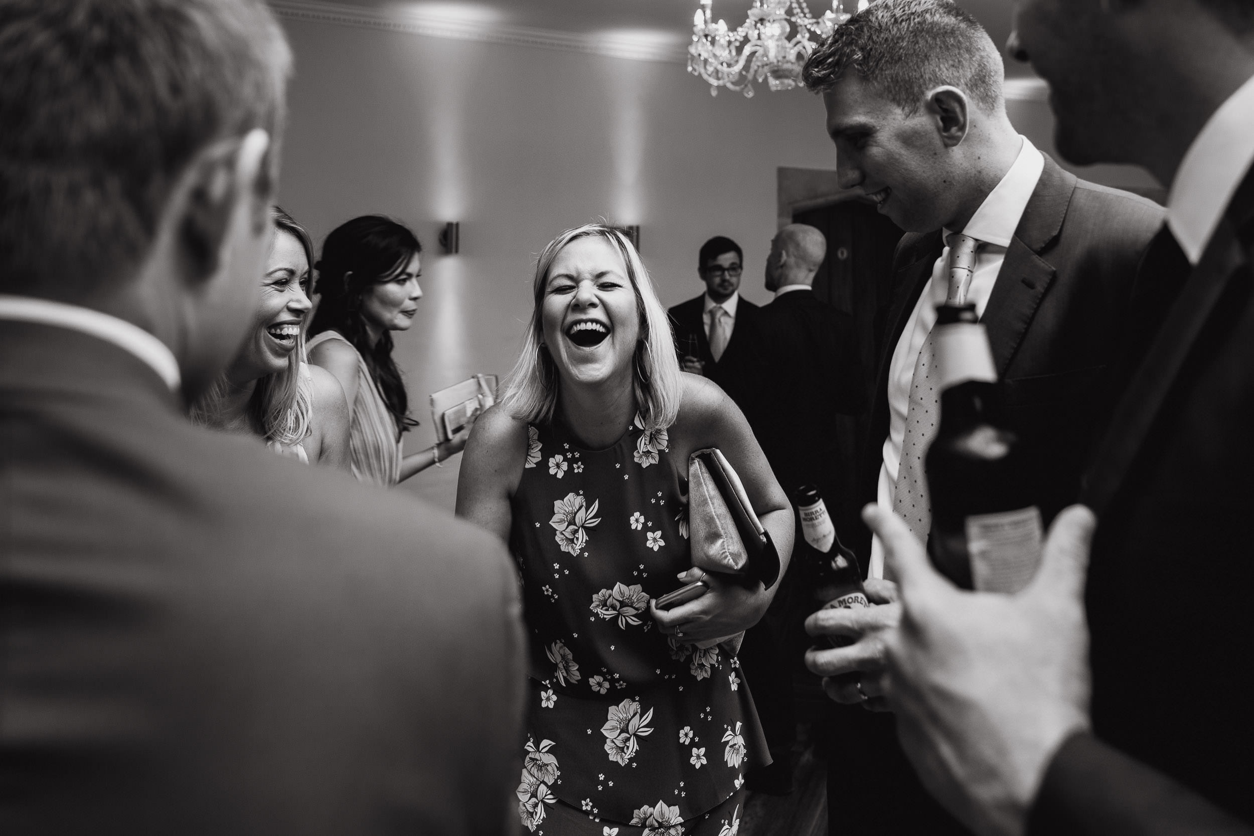 Orchardleigh Estate Wedding - Guests laughing during the Evening Reception