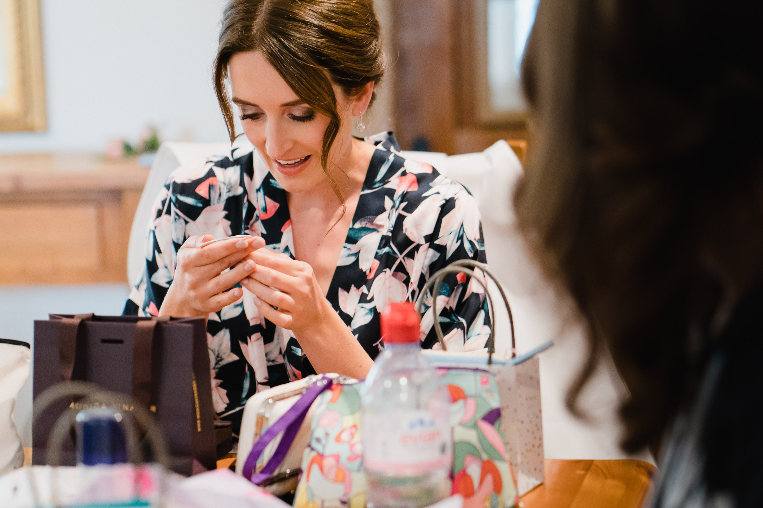 Orchardleigh Estate Wedding - Bride opening presents during Bridal Prep