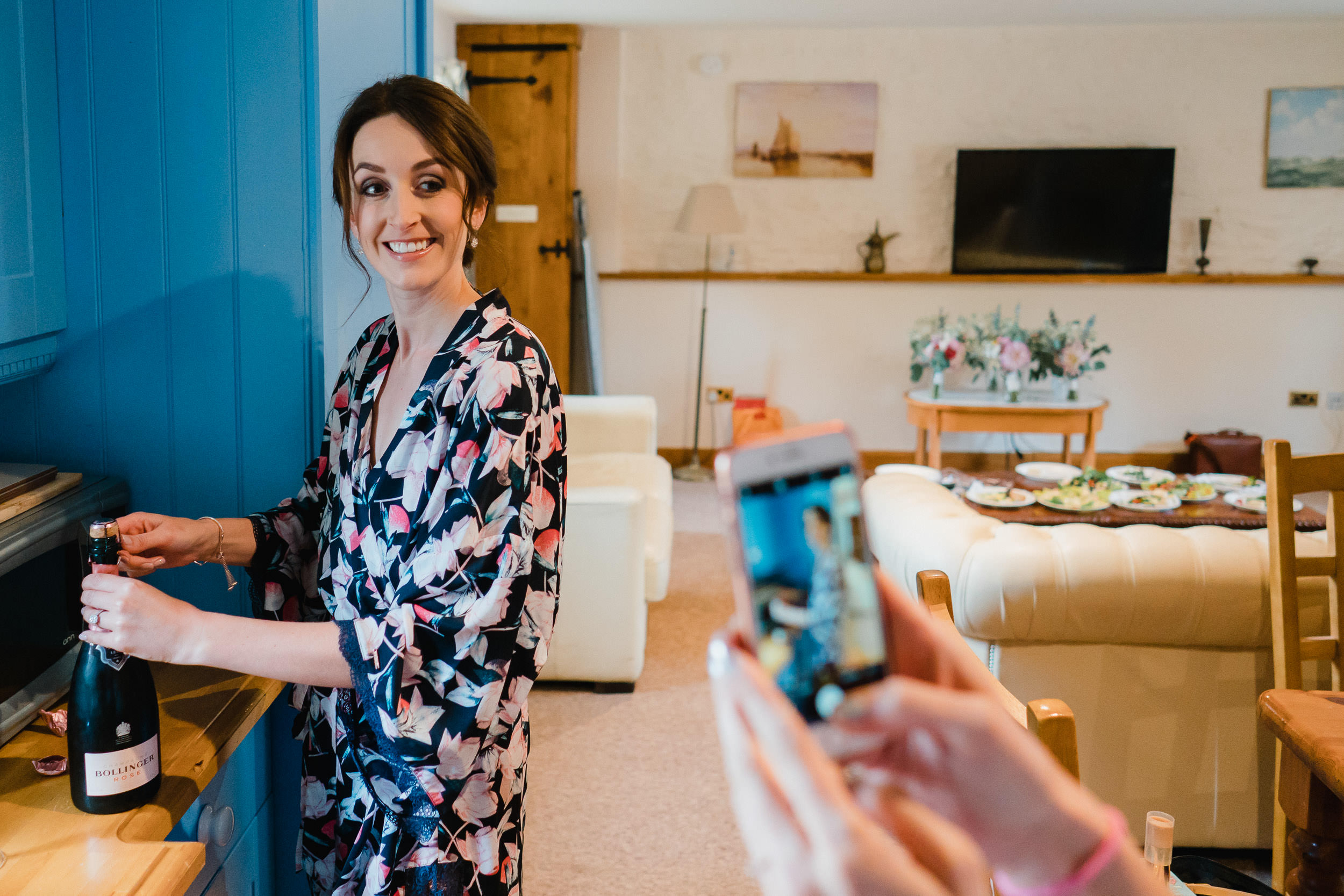 Orchardleigh Estate Wedding - Bride opening Champagne during Bridal Prep