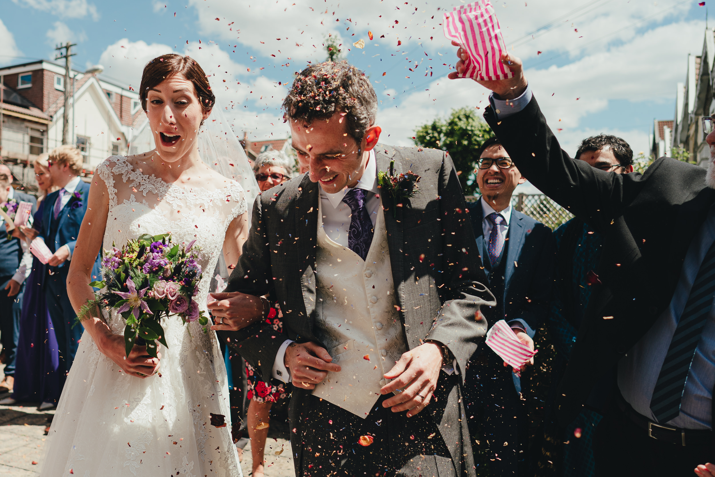 Guests throwing confetti at the Bride and Groom