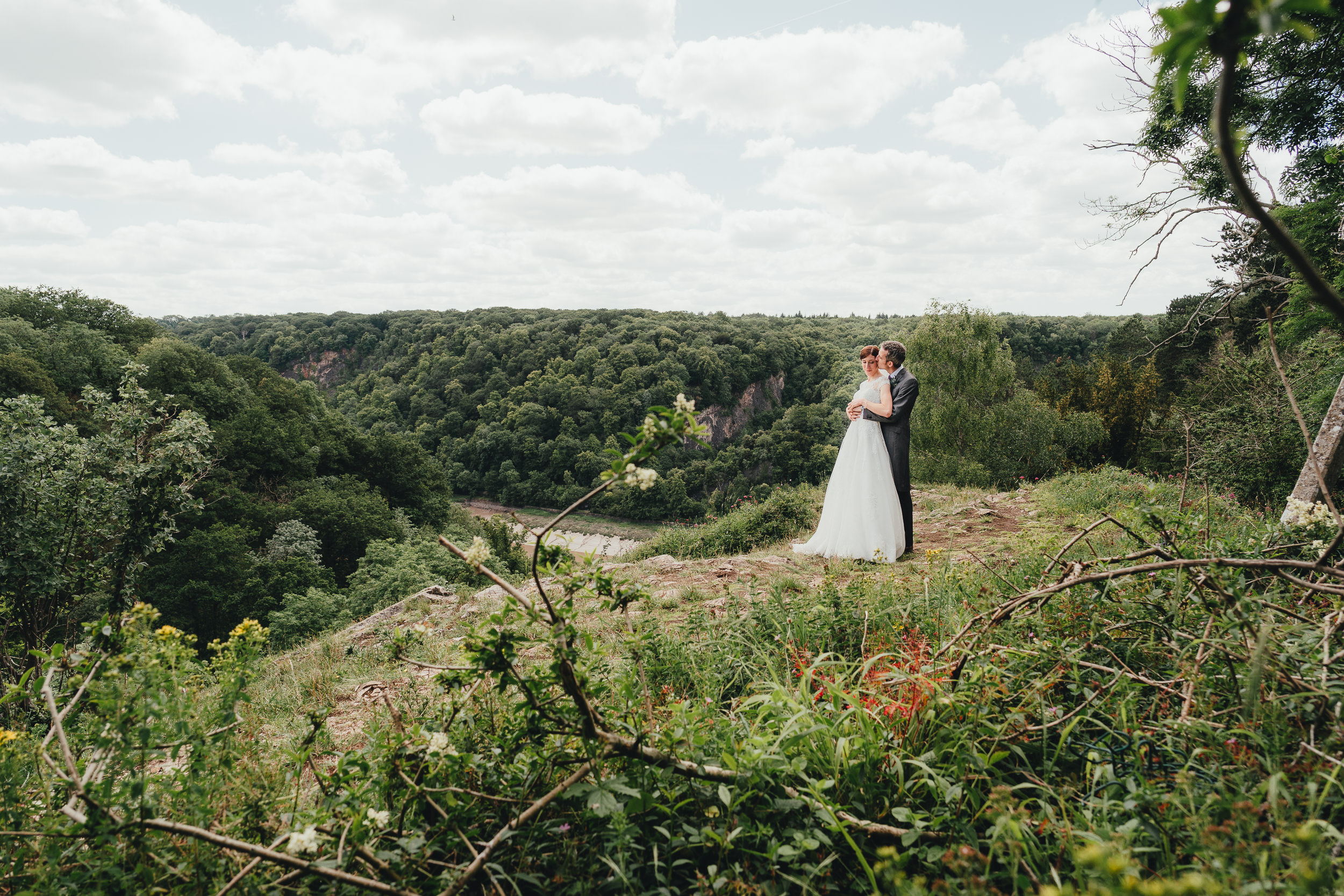 The Bride and Groom look across the Avon Gorge from the Clifton Downs
