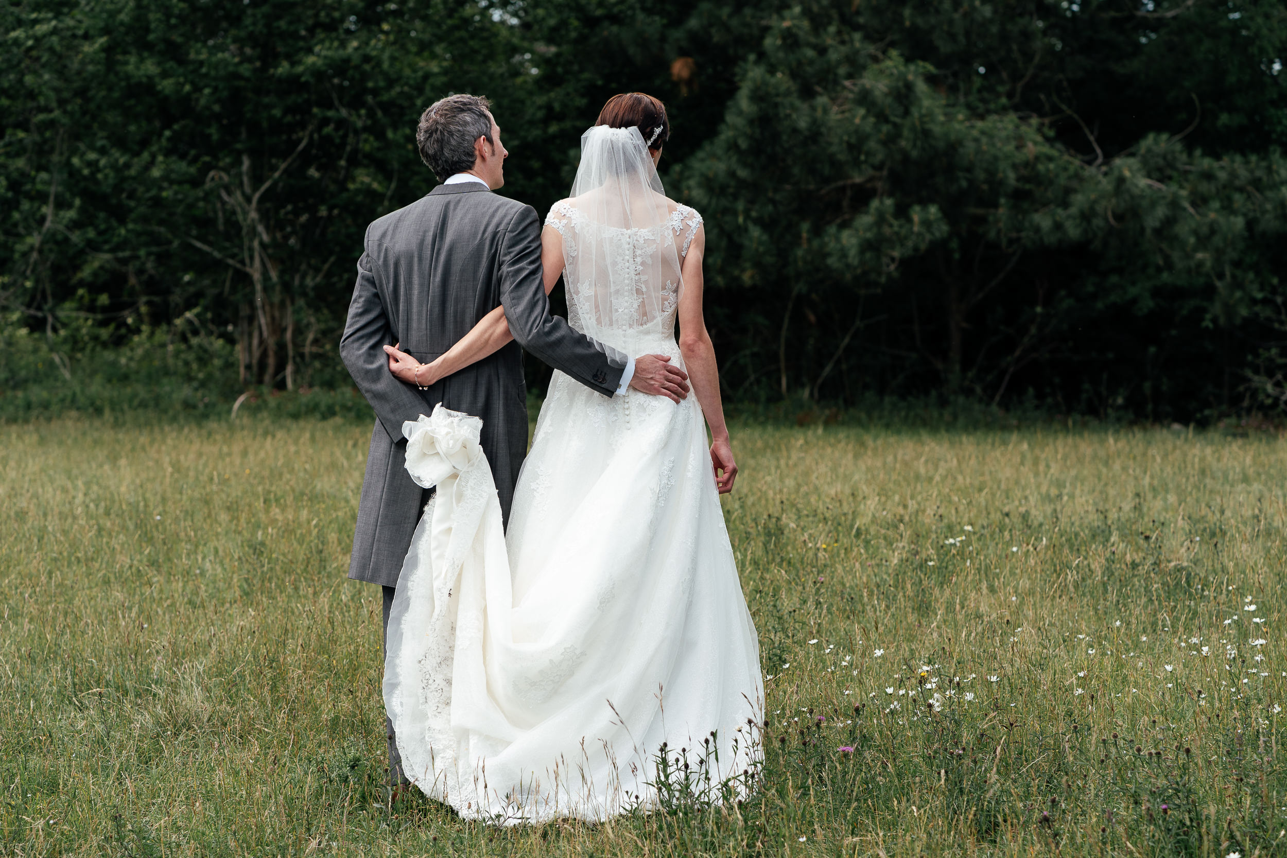 The Bride and Groom walk together on Clifton Downs