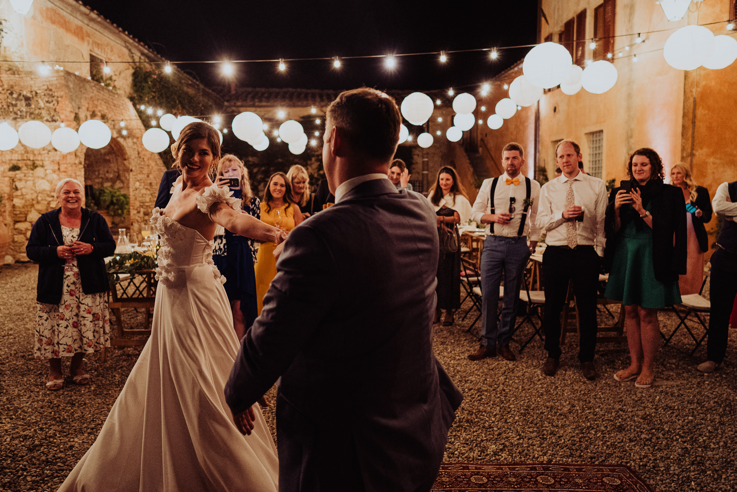 Tuscan Villa Wedding - The Bride and Groom dance in the courtyard at Villa Catignano