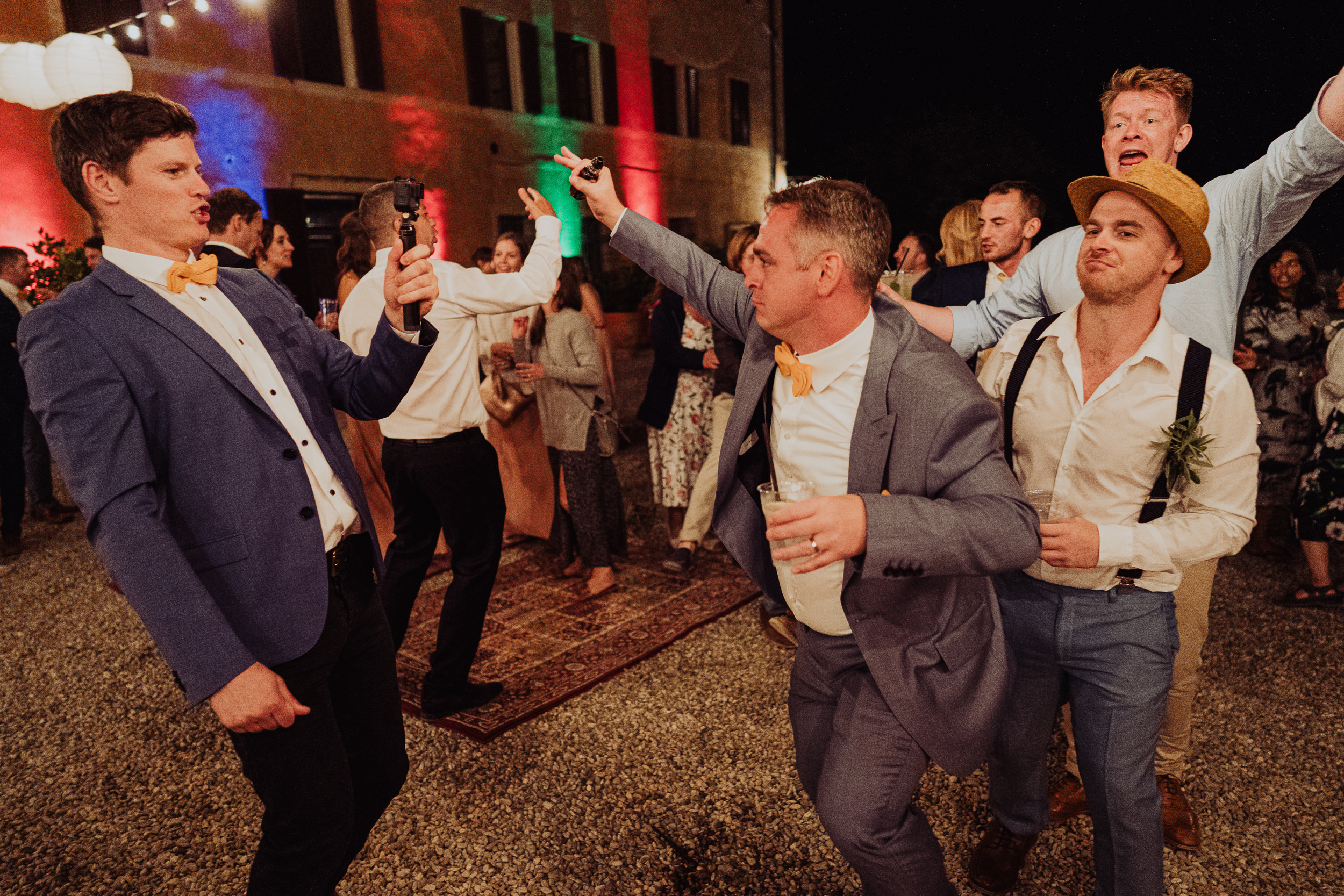Tuscan Villa Wedding - The groom leads the conga round the dancefloor