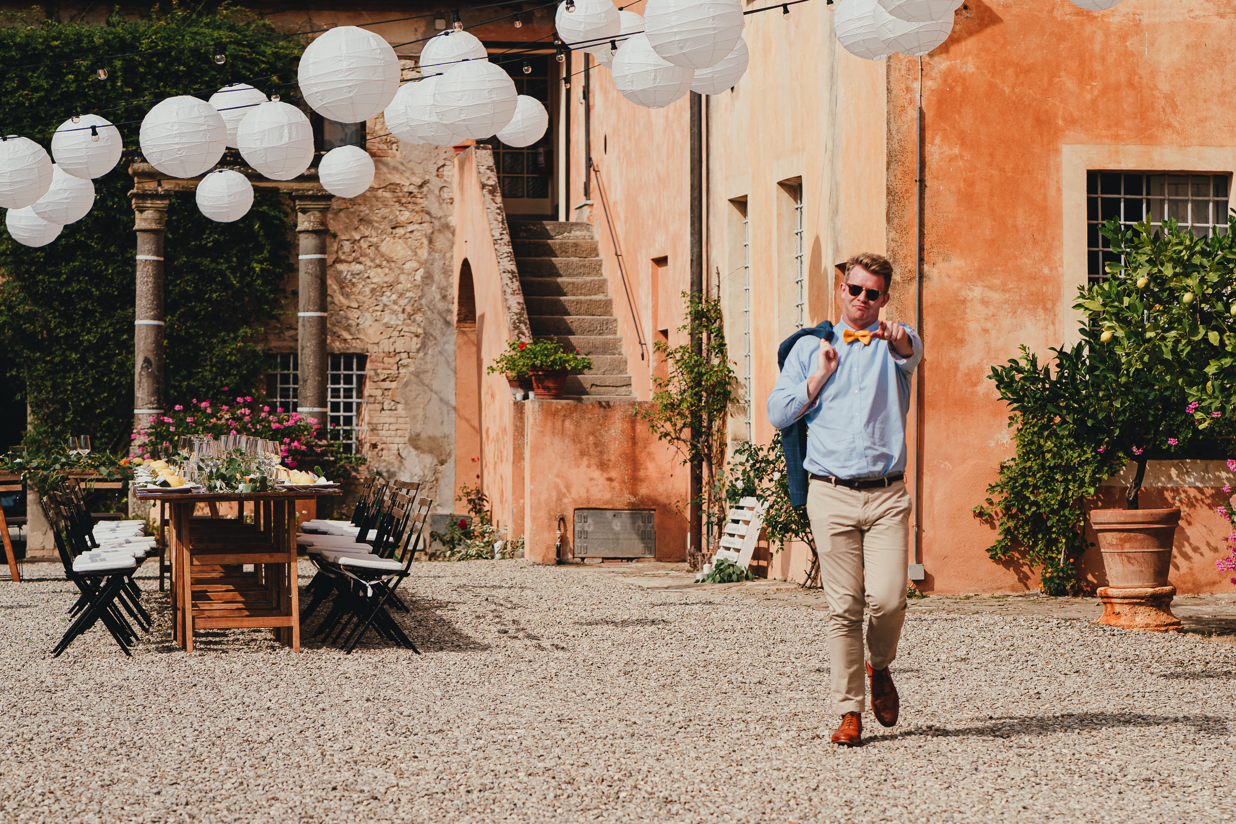 Tuscan Villa Wedding - wedding guest in the courtyard of the villa