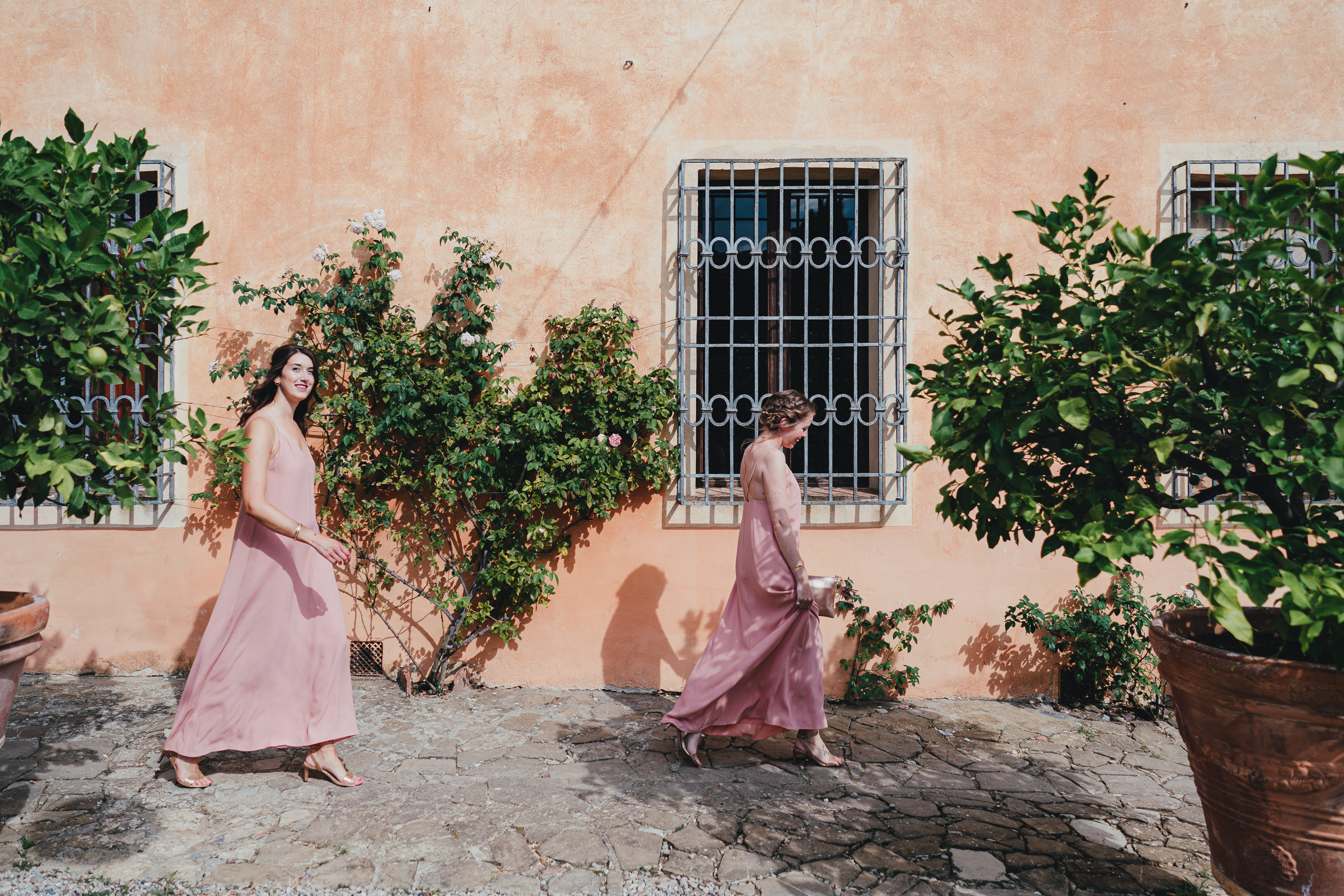 Tuscan Villa Wedding - The Bridesmaids walking around the villa