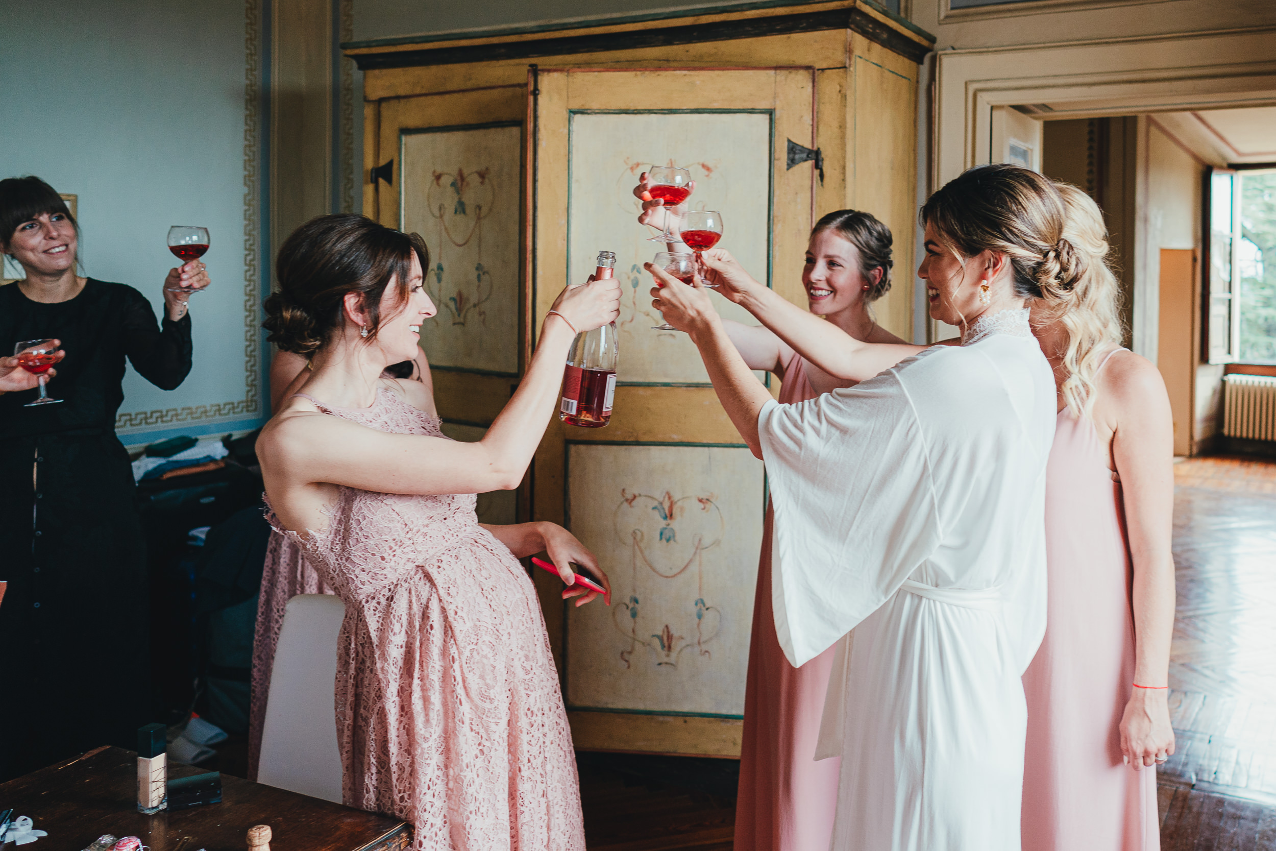 Tuscan Villa Wedding - Bride toasts with her Bridesmaids