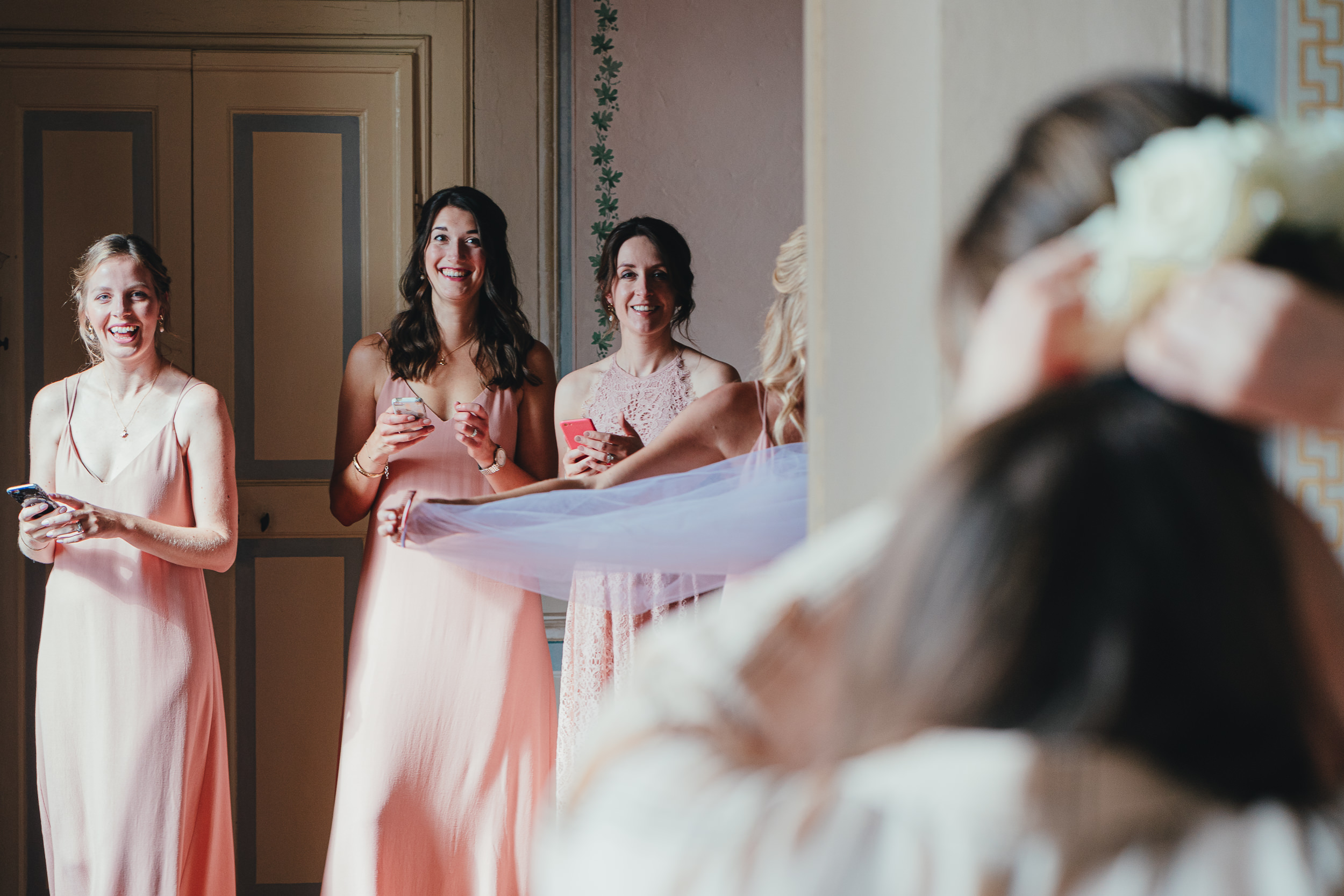 Tuscan Villa Wedding - Bridesmaids watch the Bride getting ready at Villa Catignano