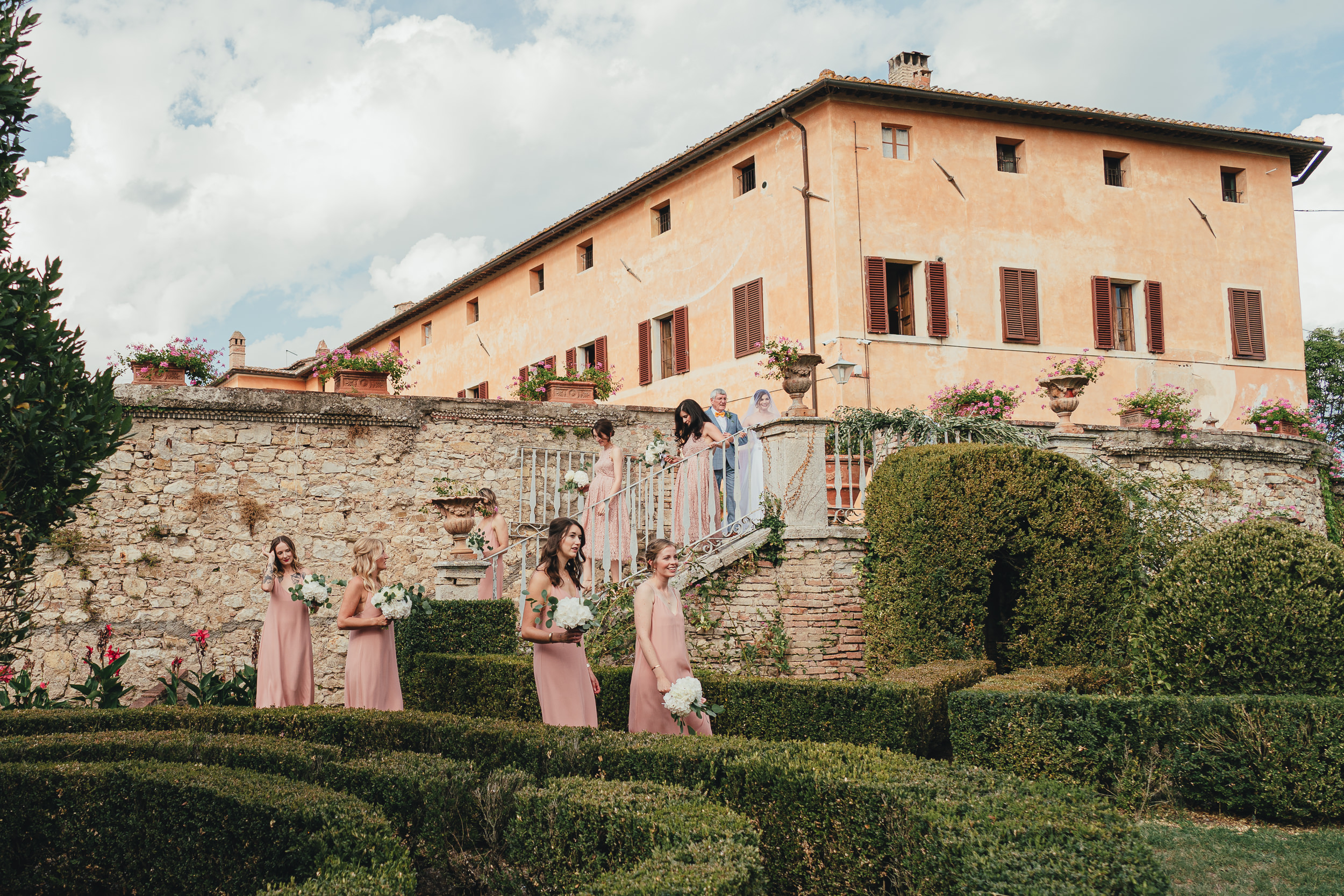 The Bridesmaids walk to the ceremony at Villa Catignano