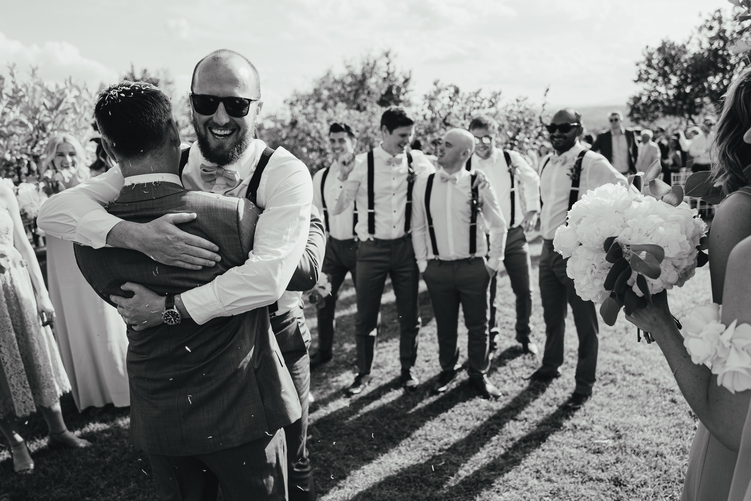 The Grooms hugs his Best Men