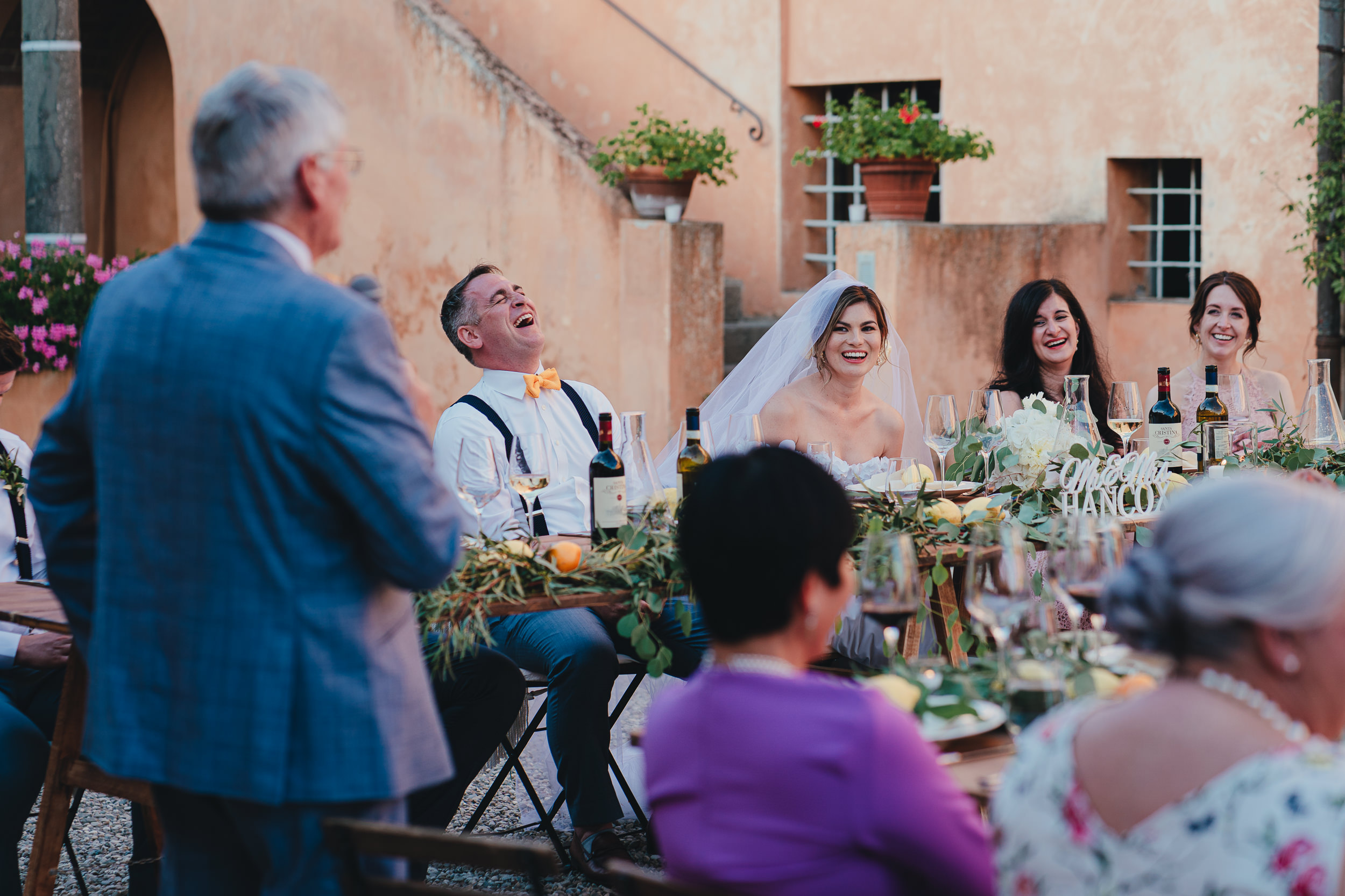 Tuscan Villa Wedding - The Groom laughing at the Father of the Bride's speech