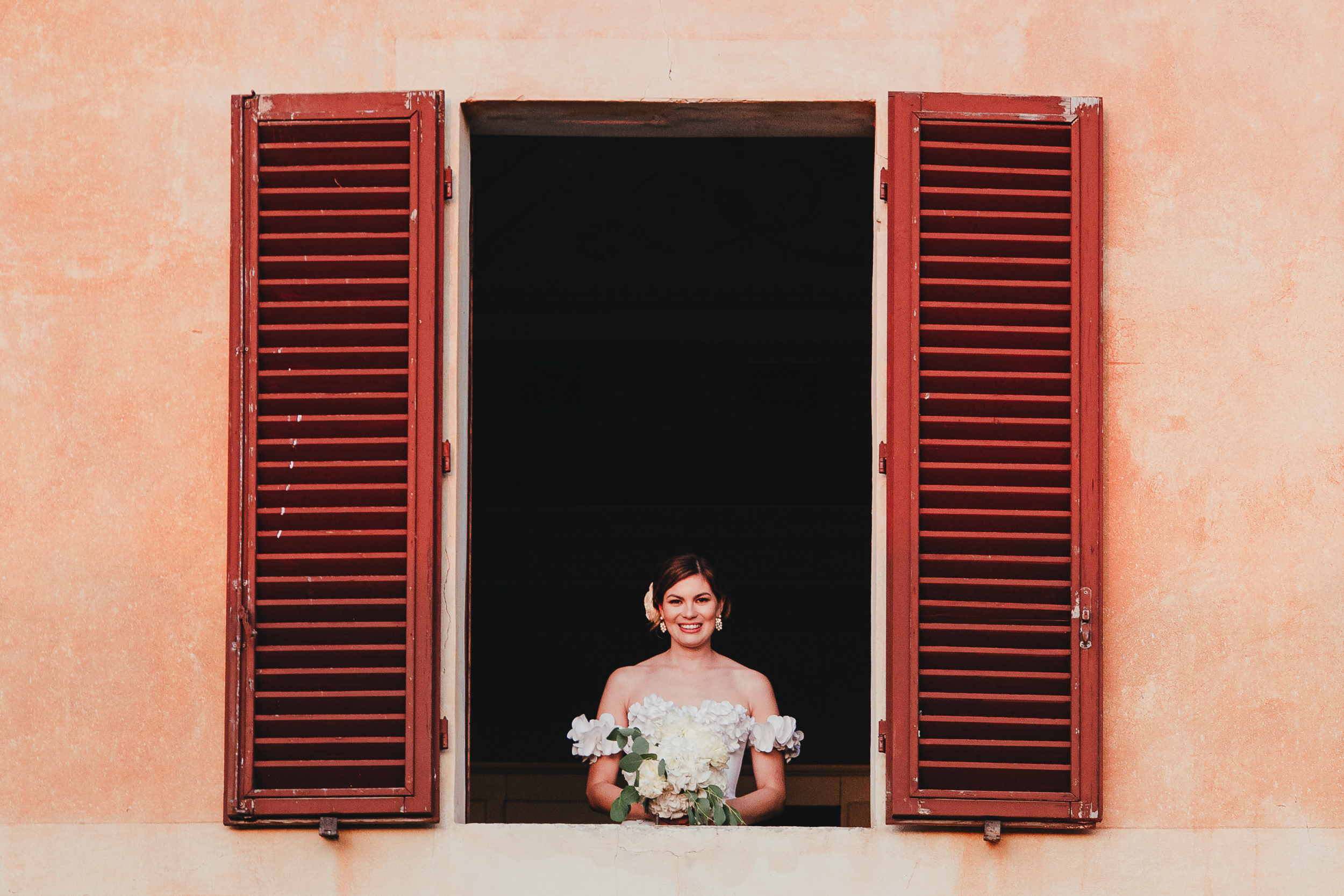 Tuscan Villa Wedding - Portrait of the Bride at the window of Villa Catignano