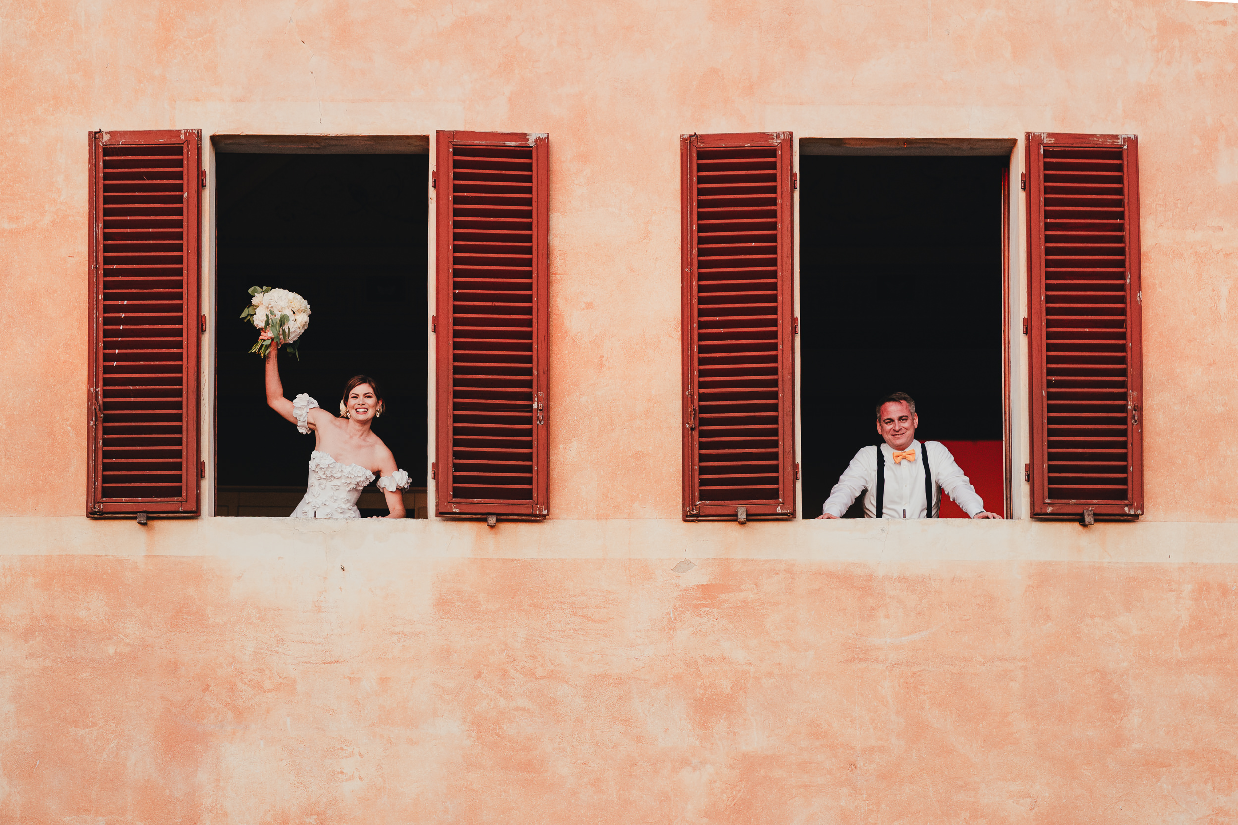 Tuscan Villa Wedding - Portrait of the Bride and Groom looking of windows
