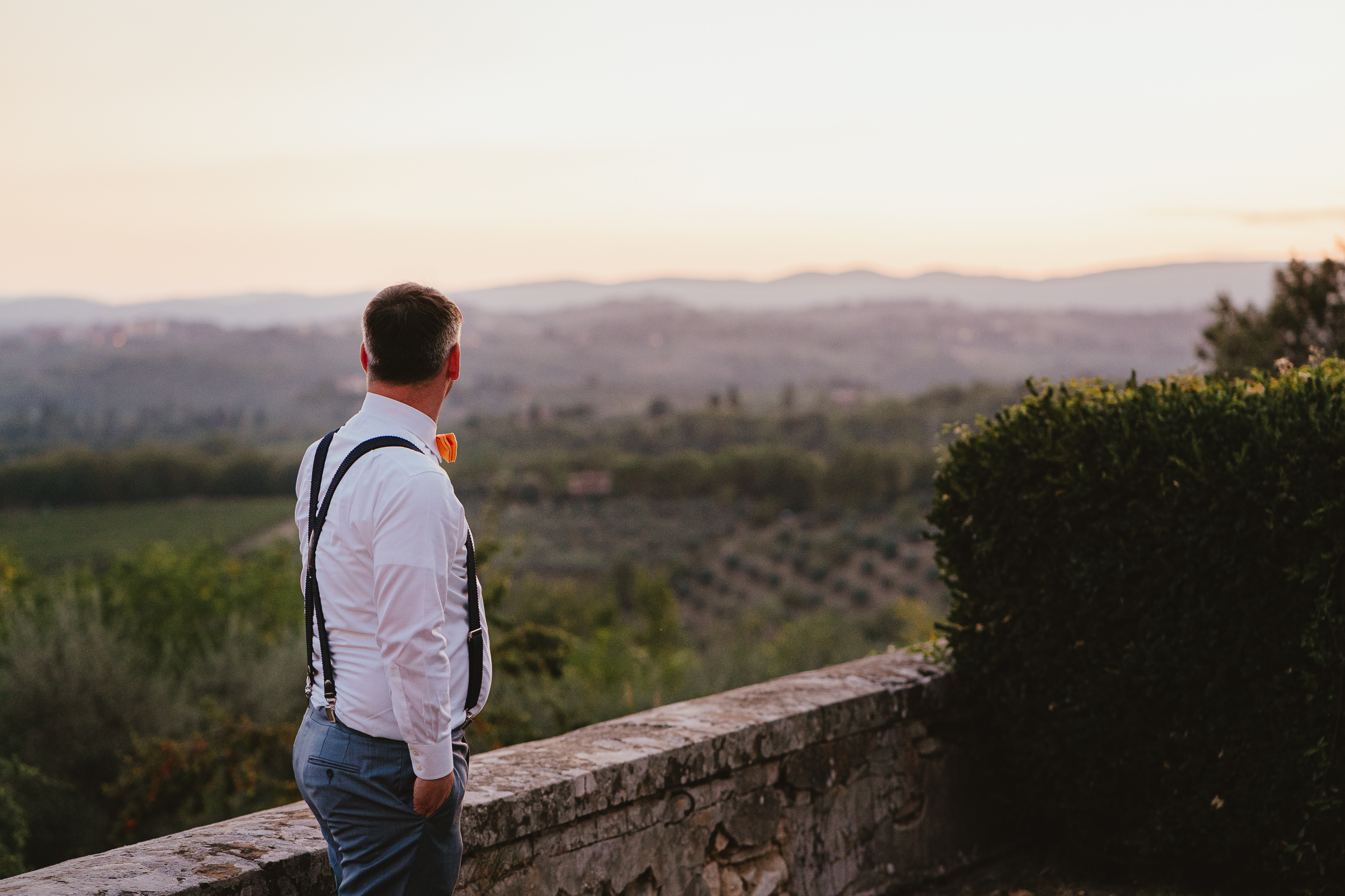 The Groom looks out at the view from Villa Catignano
